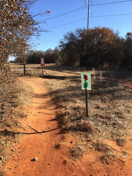 You are done with the blue trail. Follow the signs back to the green trail - do not take the red trail.