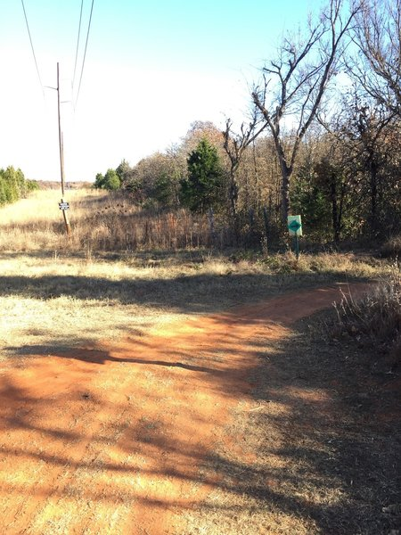 At the end of the north power line road, turn right back onto the green singletrack trail.