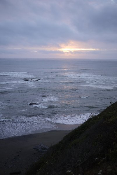 A California Sunset, admired from the rocky shores of Enderts Beach.