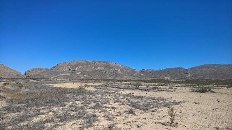 A view near the trailhead. Dog Canyon on the left, Devil's Den on the right.