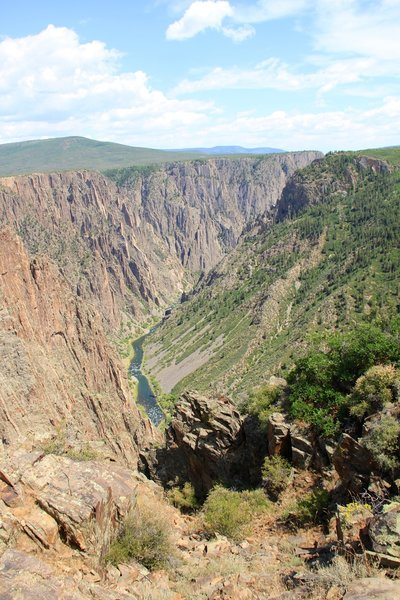 The Gunnison River far below winds away from the Pulpit Rock Overlook.