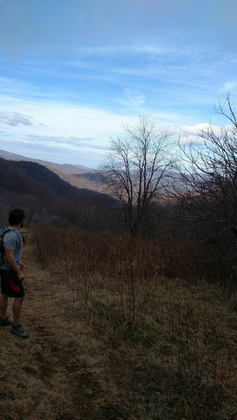 Overlooking the mountains after passing through the open farmland along the Overmountain Victory Trail in Hampton Creek Cove.