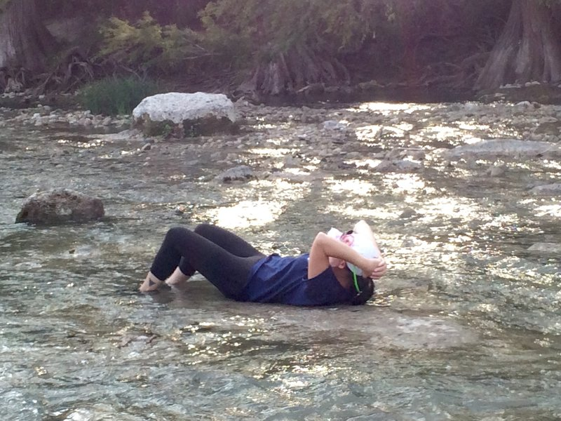 Taking a break to relax in the warm water at Guadalupe River State Park.