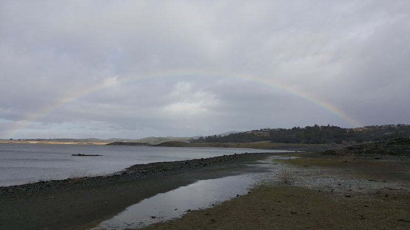 A lucky rainbow over Folsom Lake appears during a winter storm.