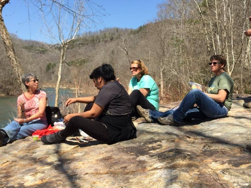 Hikers enjoy a snack by the Big South Fork Cumberland River.