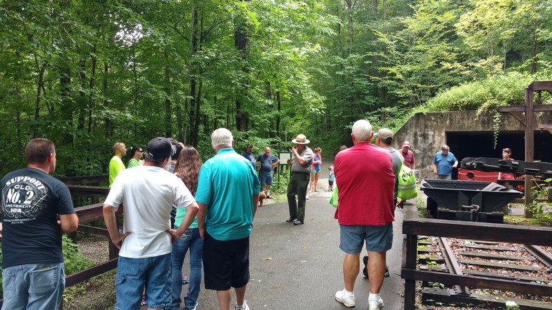 Visitors listen in as a park ranger talks about the coal mining history of Mine 18 along the Blue Heron Loop Trail.