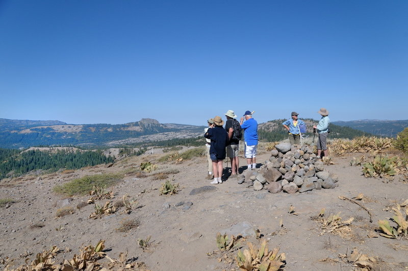 Hikers enjoy the view at the top of Rowton Peak along the Razorback Ridge Trail.