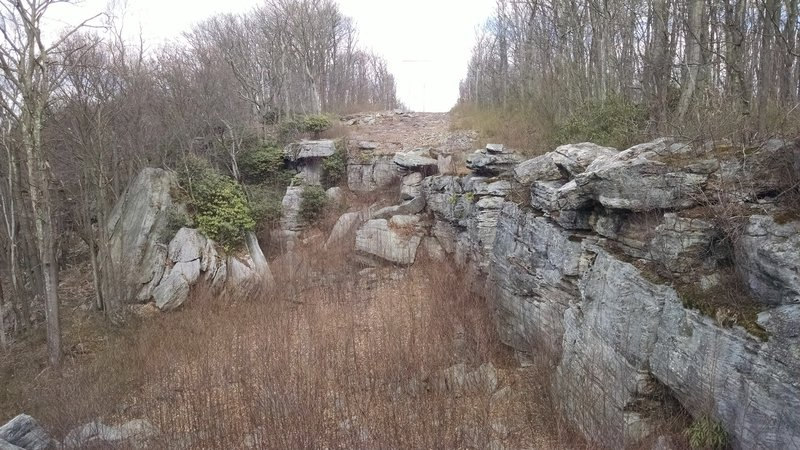 The cliffs follow alongside the Raven Rock Trail near its end.