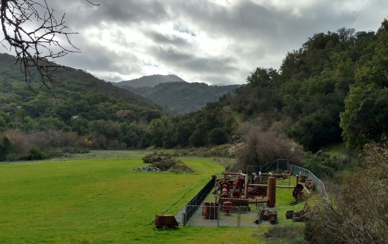 The Hacienda Entrance to Quicksilver Park features the site of the old Hacienda Furnace and Reduction Works. In the lower right, a display of old mining machinery greets visitors to the park.