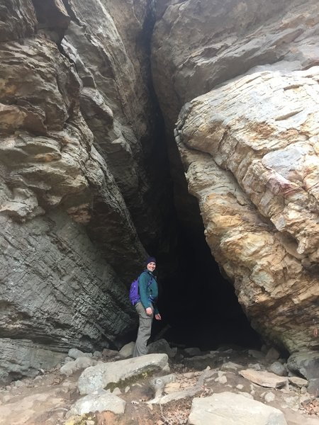 My hiking buddy enjoys a very cool small cave with flat floor. It only goes in about 20 feet, but it's a good place to take shelter from a storm.