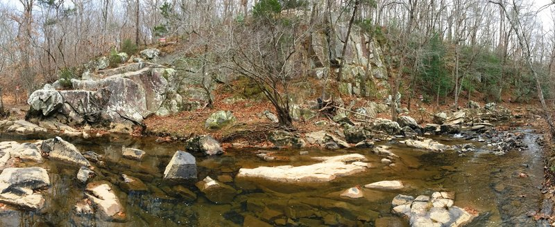The Rhodo Cliffs offer a beautiful backdrop to the waters of New Hope Creek.