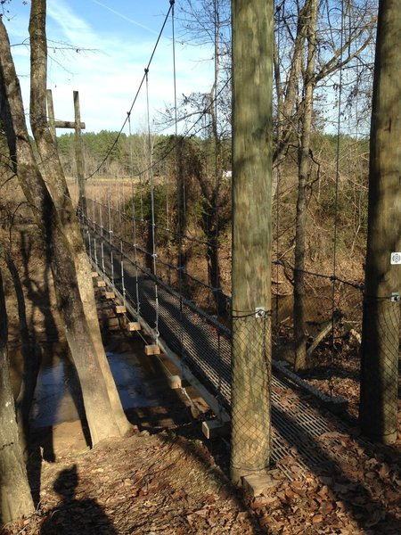 A suspension bridge provides easy passage over Adams Creek.