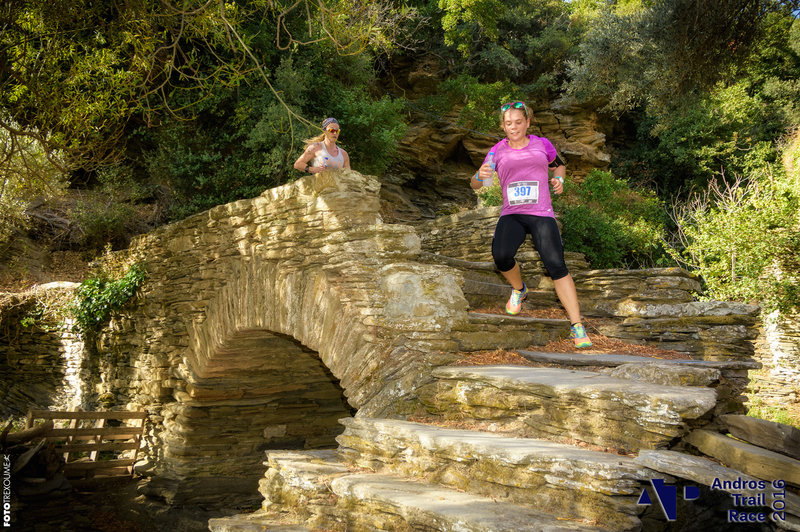 Runners navigate The Bridge of Love in Episkopeio Village.