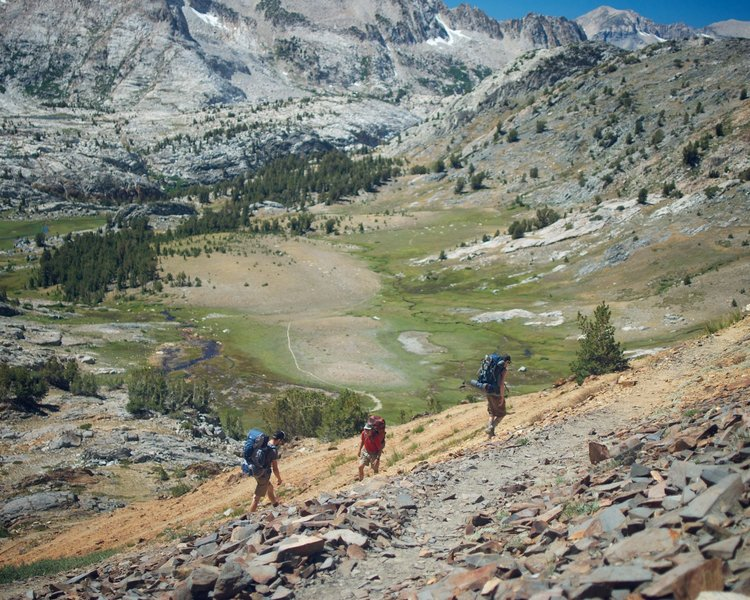 A group of backpackers cruises switchbacks on McGee Pass.
