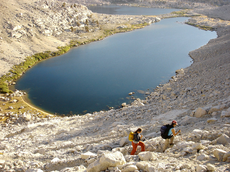 A pair of hikers climbs from the Cottonwood Lakes up Old Army Pass in Sequoia National Park.