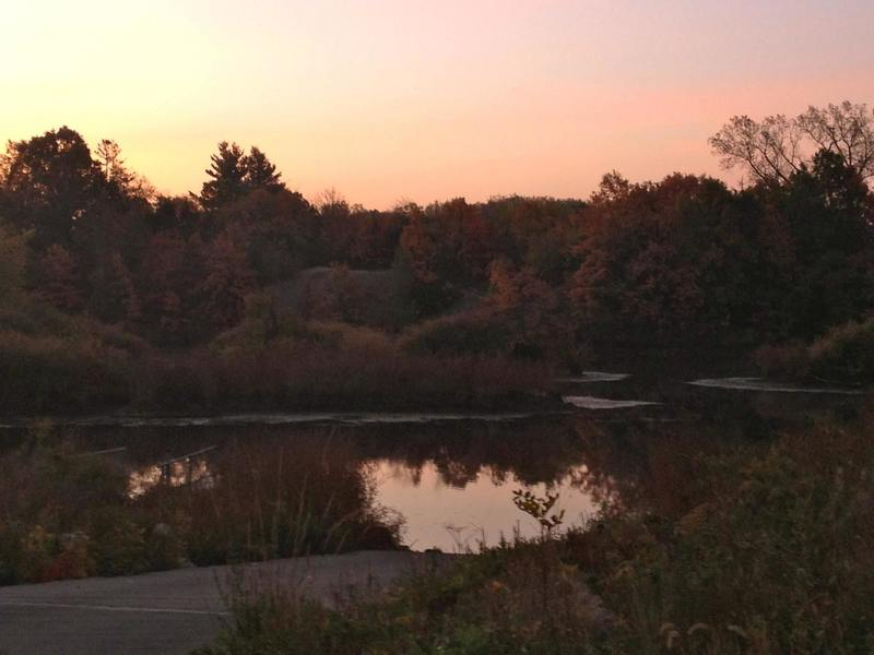 A beautiful sunrise reflects off the water at Banner Lakes in Summerset State Park.
