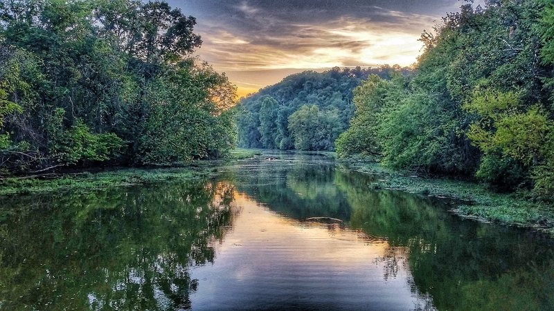 A sunset offers a beautiful backdrop to the meandering waters of the James River.