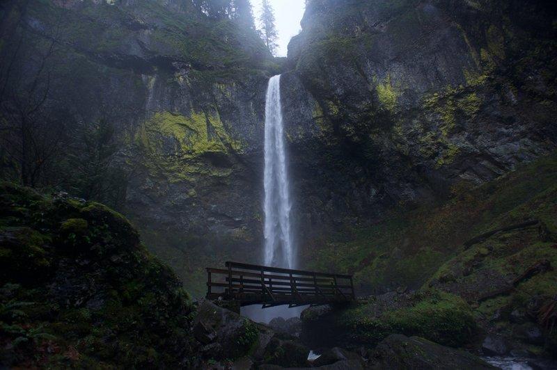 A picturesque footbridge crosses McCord Creek Falls below Elowah Falls.