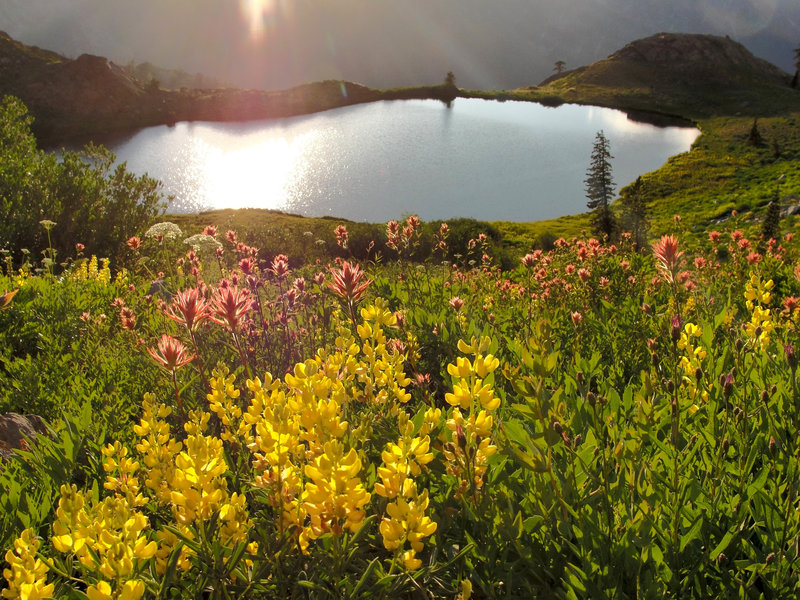 The sun sets over Diamond Lake on the Four Lakes Trail.