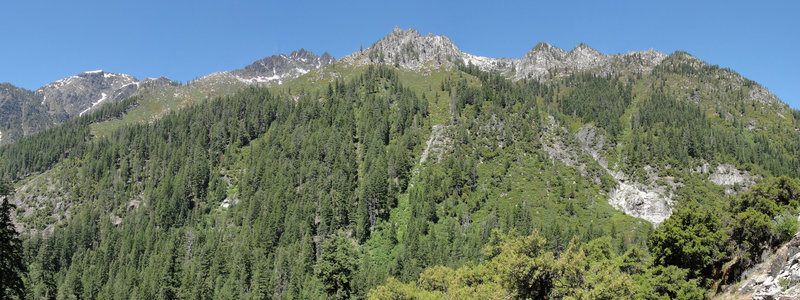 Tall evergreens line the canyon along the Canyon Creek Lakes Trail.