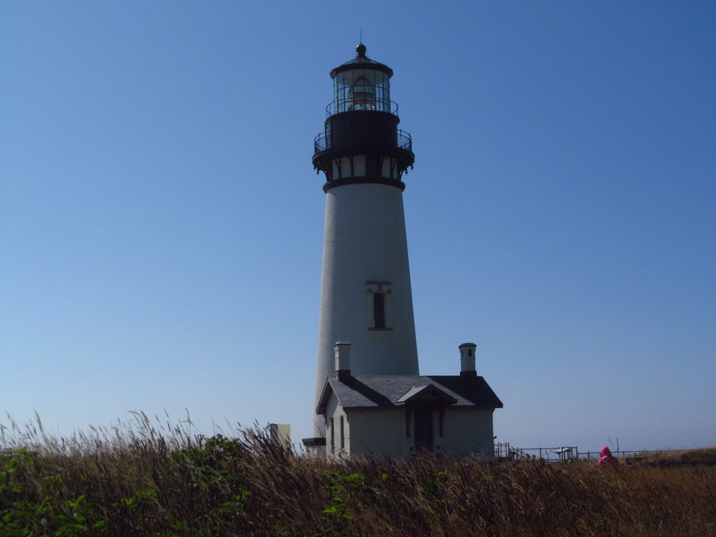 Yaquina Head Lighthouse ushers vessels safely into harbor off the coast of Agate Beach.