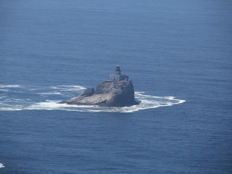 Tillamook Rock Lighthouse stands prominently off the coastline.