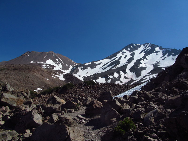 Mt. Shasta (R) and Shastina (L) tower above the talus fields of Hidden Valley.