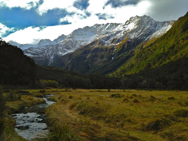 Snowy Somnus guards a serene alpine valley.