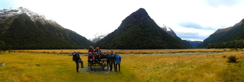 Our group poses outside Flats Hut with Conical Hill serving as the backdrop.