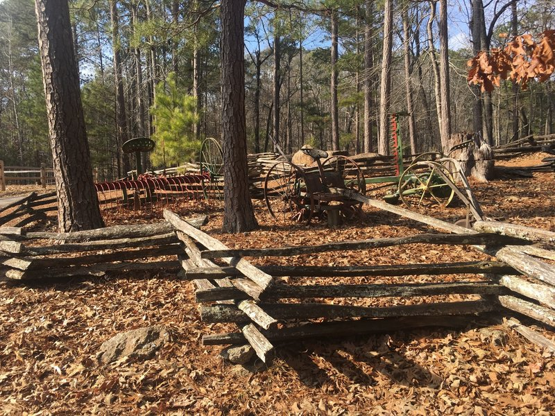 Antique Farm Equipment is on display along the Lakeside Trail.