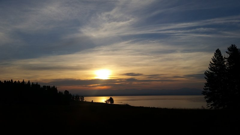 Yellowstone Lake erupts in an orange afterglow at the end of each day.