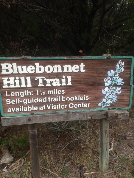 This is a trailhead sign for the Bluebonnet Hill Trail at Cedar Ridge Preserve.