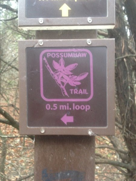 This is a trailhead marker for the Possumhaw Trail at Cedar Ridge Reserve.