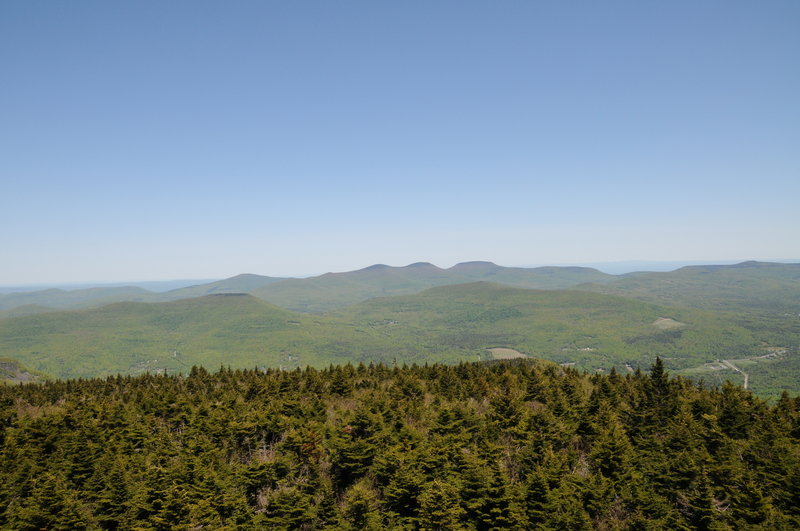 Hunter Mountain's summit fire tower offers phenomenal views toward Thomas Cole, Black Dome, and Blackhead Mountain.