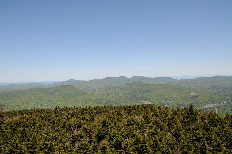 Hunter Mountain's summit fire tower offers phenomenal views toward Thomas Cole, Black Dome, and Blackhead Mountain.