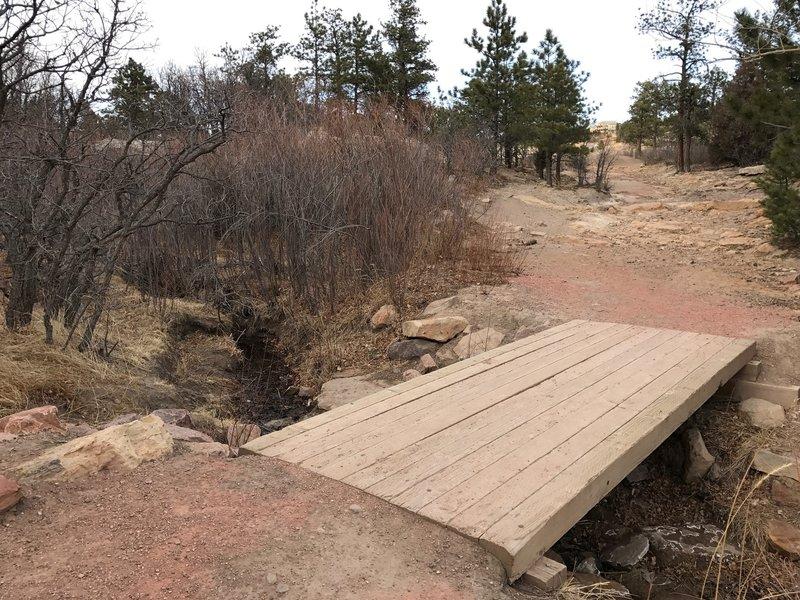 Wooden bridge near the parking lot.