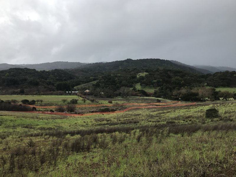 The trail re-enters Rancho San Antonio, and views of the hills above the preserve come into view.