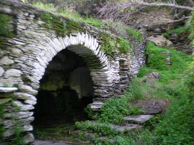 Hones Spring is shadowed by a beautiful stone bridge.