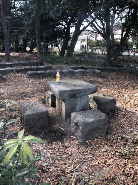 A stone table makes for a great lunch spot along the water's edge.