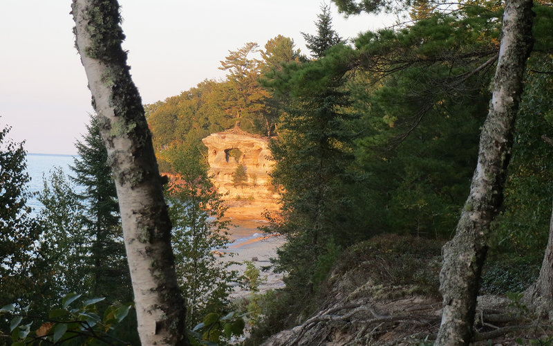 Chapel Rock peeks through the trees along the North Country Trail.