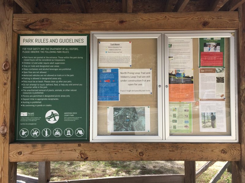 The Anderson Creek Park rules, notices, and precautions are listed on this board near the trailhead. Check here for trail conditions.