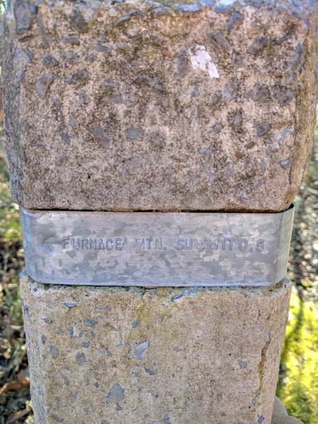 This is a marker on the way to the Furnace Mountain Summit.