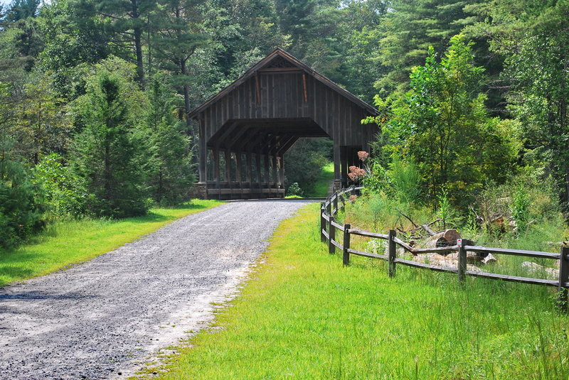 Enjoy this covered bridge on Buck Forest Road above High Falls at DuPont State Forest.