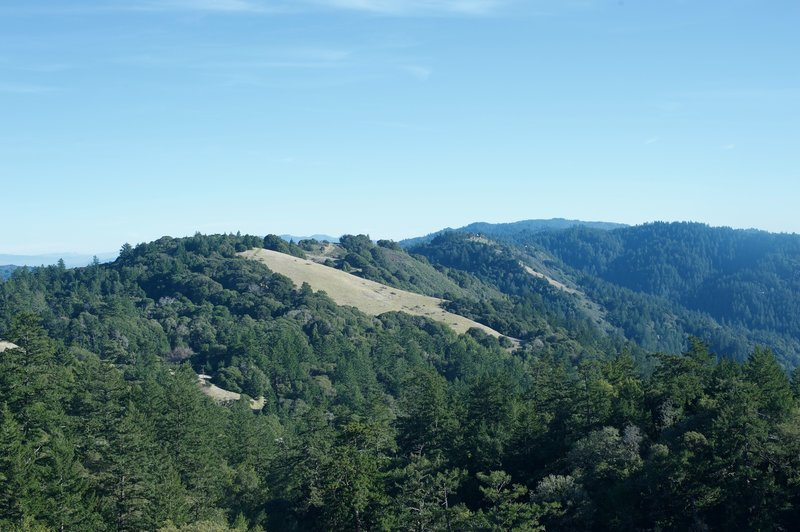 Enjoy this view of the surrounding mountains from the Ancient Oaks Connector Trail. Meadows, possibly created by early Native American inhabitants, can be found throughout the area.