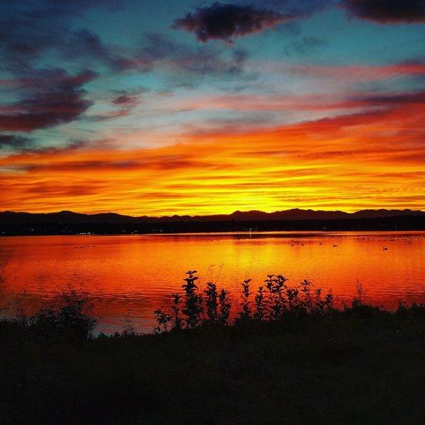 The sun sets at Sloan's Lake Park.