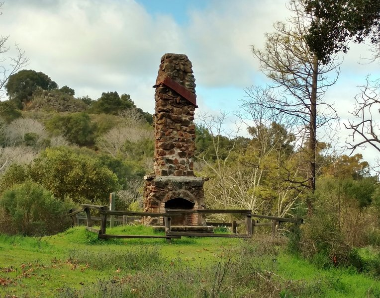 An old fireplace and chimney marks all that's left of a miner's house perhaps?