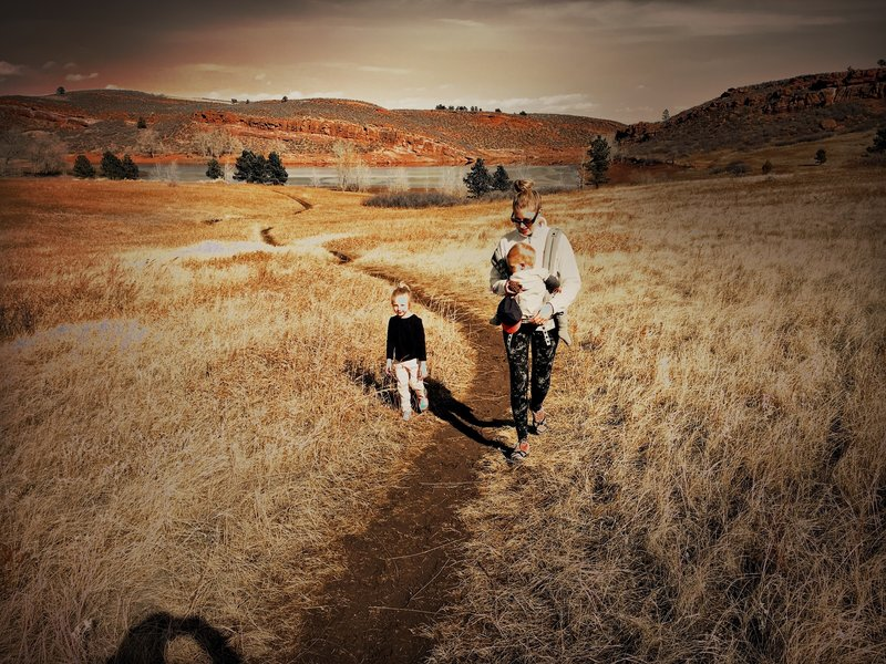 Our family hiking through the flat, open landscape of the trail.
