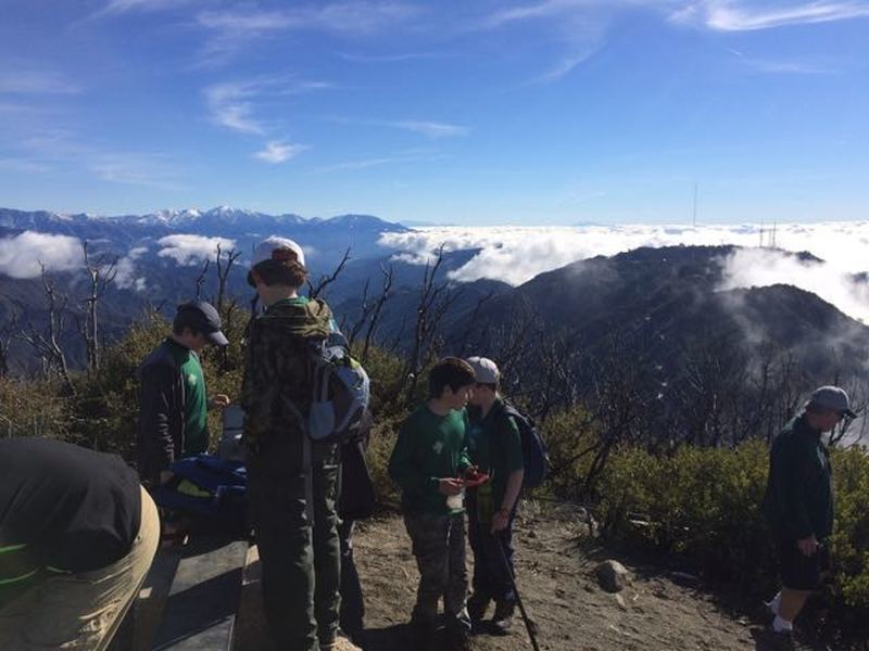 Our group checks out the view and the geocache at the top of San Gabriel Peak.