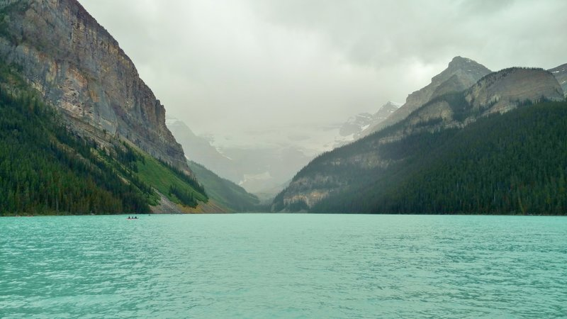 Lake Louise poses with Victoria Glacier at its far end and Mt. Victoria hidden in the clouds.