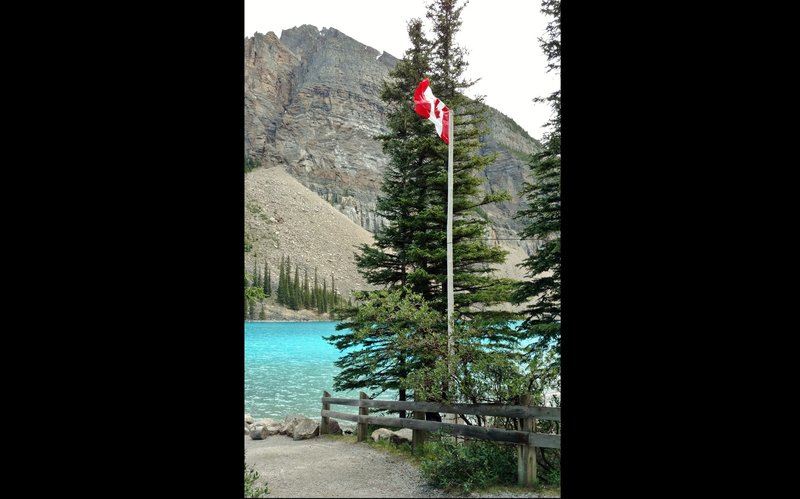 The Tower of Babel (right portion) stands on the opposite side of Moraine Lake from the walking path.